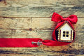 Small House With Red Ribbon And Key Royalty Free Stock Photo - 68954315