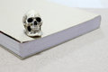 Still Life With A Skull And Book On Wooden Table Royalty Free Stock Photo - 68957405