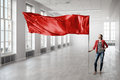Woman Holding Red Flag Royalty Free Stock Images - 68980049