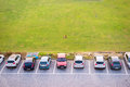 Top View Of Parking Multi-storey Building And Dog Lying On Green Royalty Free Stock Photography - 69017587