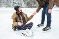 Man Helping Girl To Stand On The Ice Rink Stock Photography - 69019452