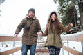 Couple Holding Hands And Running Down The Stairs In Winter Stock Image - 69019911