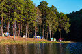Dome Tents Near Lake And Pine Trees In Camping Site At Pang Ung Royalty Free Stock Image - 69044016