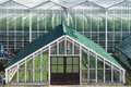 An Old Grapes Greenhouse In Front Of A Modern High One. Royalty Free Stock Photography - 69050947