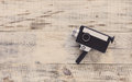 Classic Vintage Old 8mm Movie Camera On Old Wooden Boards. Hipster Style. Top View With Copy Space. Free Space For Text. Royalty Free Stock Photos - 69051768