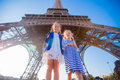 Adorable Little Girls In Paris Background The Eiffel Tower Stock Photos - 69063153