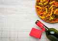 Bottle Wine, Colored Fusilli Pasta And Copy Space Royalty Free Stock Photo - 69065615