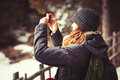 Adventure Tourist Woman Taking A Picture. Hiking Stock Photo - 69093310
