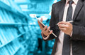 Businessman Using The Tablet On Abstract Blurred Photo Of Book Store Royalty Free Stock Images - 69138109