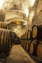 Wine Barrels Stacked In The Old Cellar Stock Images - 69146134