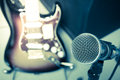 Microphone, Blur Guitar Background. Stock Photography - 69149872