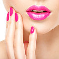 Closeup Woman Hand With Pink Nails Near Lips. Royalty Free Stock Photography - 69153377