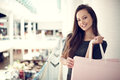 Beautiful Woman With Shopping Bags In Big Mall. Royalty Free Stock Photos - 69154178
