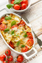 Casserole With Farfalle Pasta, Cherry Tomato, Mozzarella Cheese And Herbs Stock Photography - 69172312
