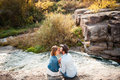 Beautiful Couple Hugging Each Other Near A Mountain River Stock Photography - 69183702