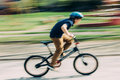 Boy Riding A Bike Stock Images - 69199924