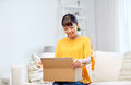 Happy Asian Young Woman With Parcel Box At Home Stock Image - 69204761
