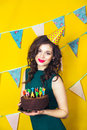 Beautiful Caucasian Girl Blowing Candles On Her Cake. Celebration And Party. Stock Photo - 69212880