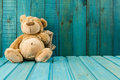 Teddy Bear On Turquoise Wooden Background. Stock Photo - 69242070