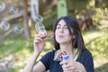 Young Woman Makes Soap Bubbles Royalty Free Stock Photos - 69261478