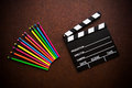 Wooden Desktop With Colorful Pencil And Movie Clapper Board Royalty Free Stock Photos - 69269548