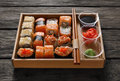 Set Of Sushi Maki And Rolls At Black Rustic Wood. Royalty Free Stock Photo - 69289505