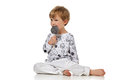 Blond Baby Boy In Pijama With Candys Royalty Free Stock Image - 69305156