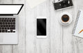 White Smart Phone With Isolated Screen For Mockup On Office Desk. Royalty Free Stock Photo - 69334525
