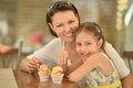 Girl And Mother Eating Ice Creams Royalty Free Stock Photos - 69344158