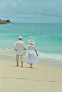Elderly Couple Rest At Tropical Beach Royalty Free Stock Photography - 69344687