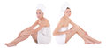 Two Young Beautiful Women After Shower Wrapped In Towel Sitting Stock Photos - 69345213