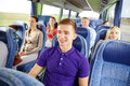 Happy Young Man Sitting In Travel Bus Or Train Stock Photography - 69352802
