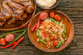 Famous Thai Food, Papaya Salad And Grilled Chicken Stock Photos - 69383773