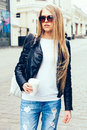 Portrait Of A Young Beautiful Blonde Girl With Sunglasses Walking On The Streets Of Europe With Coffee. Outdoor. Warm Color. Stock Photo - 69397070