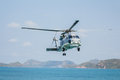Helicopter Flying Over The Sea Stock Photo - 69404440