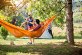 Couple In Love Toasting With Beer In Hammock Stock Photo - 69416220