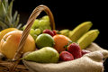 Horizontal Closeup Detail On A Basket Full Of Fruit On A Dark Background Stock Photo - 69428500