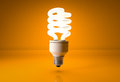 Energy Saving Light Bulb On Orange Background Stock Photos - 69455463