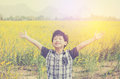 Boy At Flower Field In Morning Stock Photography - 69456342