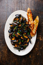 Mussels And Bread Toasts Stock Photo - 69460910