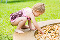 Cute Little Child Girl In  Playing With Stones On A Pebble Beach Royalty Free Stock Photography - 69467697
