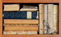 Book Shelf. Vintage Books Collection, Antique Book Textured Covers, Old Fashion Spectacles. Aged Wooden Shelf Frame Stock Photo - 69476490