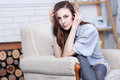 An Attractive Flirty Young Brunette Is Sitting In A Large Soft Chair Royalty Free Stock Photos - 69518858