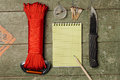 Overhead View Of Survival Gear Equipment To Survive And Notebook Royalty Free Stock Photos - 69535388