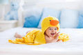 Cute Baby After Bath In Yellow Duck Towel Stock Photos - 69558613