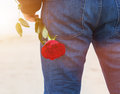 Man With A Rose Behind His Back Waiting For Love. Romantic Date On The Beach Royalty Free Stock Photo - 69568305