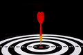 Red Dart Arrow Hitting In The Target Center Of Dartboard Stock Photo - 69572410