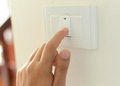 Hand With Finger On Light Switch, Stock Images - 69573454