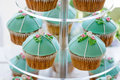 Wedding Cupcake Tower Stand With Turquoise Cakes. Stock Photo - 69574020