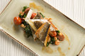 Pan Fried Sea Bass With Crayfish, Chorizo, Baby Spinach & Cherry Tomatoes Royalty Free Stock Photography - 69578827